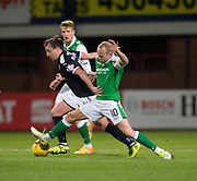 24th January 2018, Dens Park, Dundee, Scottish Premiership, Dundee versus Hibernian; Hibernian's Dylan McGeouch tackles Dundee's Paul McGowan