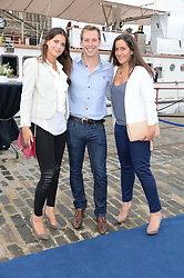 Johnnie Walker Gold Label Reserve Finale Celebration Party aboard the John Walker & Sons Voyager moored at the Prince of Wales Docks, Leith, Edinburgh, Scotland on 14th August 2013.<br /> Picture shows:-Left to right, Anne Macpherson, David Carry and Beccie Smith