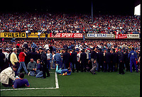 A Liverpool Fans spill onto the pitch and also climb to the above stand for safety<br />The Tragic FA Cup Semi Final between Liverpool Vs Nottingham Forest where Sadly 96 Liverpool fans lost their lives because of Overcrowding at the Hillsborough Stadium Sheffiled 15th April 1989<br />PHOTO ROBIN PARKER FOTOSPORTS INTERNATIONAL