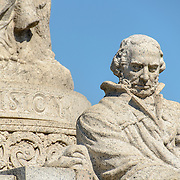 John Ericsson National Memorial with Vision Inscription. The John Ericsson National Memorial, on the bank of the Potomac River near the Lincoln Memorial, is a monument to Civil War naval engineer John Ericsson, the designer of the breakthrough iron-clad naval vessel USS Monitor. The memorial was designed by architect Albert Randolph Ross and sculpted by James Earle Fraser from the same pink granite used in the Lincoln Memorial. Because Ericsson was Swedish-born, the memorial consists of a combination of symbolic elements from his birthplace and his adopted homeland.