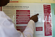A poster showing the Diagnosis of Obstetric Fistula on the wall at Kitovu Hospital, Uganda.
