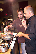 "Chef J. Geoffery Johnson, executive chef at Copper Fish in Cape May, NJ demonstrates during the Atlantic City Food & Wine Festival. Assisting Chef Johnson is Rocky Fino, author of the cookbook ""Will Cook For Sex."""