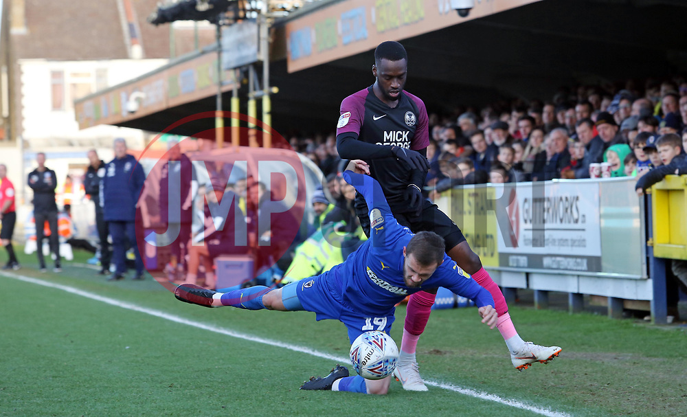 Mohamed Eisa of Peterborough United in action with Shane McLoughlin of AFC Wimbledon - Mandatory by-line: Joe Dent/JMP - 18/01/2020 - FOOTBALL - Cherry Red Records Stadium - Kingston upon Thames, England - AFC Wimbledon v Peterborough United - Sky Bet League One