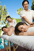 Couple having massage at health spa