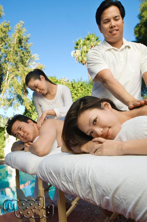 Couple having massage at health spa
