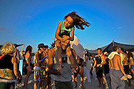 "Father and daughter dancing on the beach at ""Mid Burn"" the Israeli ""Burning Man Festival"" held at ""Habonim"" beach north of Israel October 4-6, 2012."