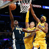 02 October 2017: Denver Nuggets guard Emmanuel Mudiay (0) goes for the layup past Los Angeles Lakers forward Kyle Kuzma (0) and Los Angeles Lakers guard Corey Brewer (3) during the Denver Nuggets 113-107 victory over the LA Lakers, at the Staples Center, Los Angeles, California, USA.