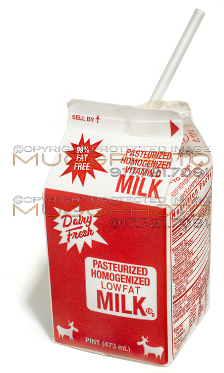 pint of milk with straw photographed on a white background