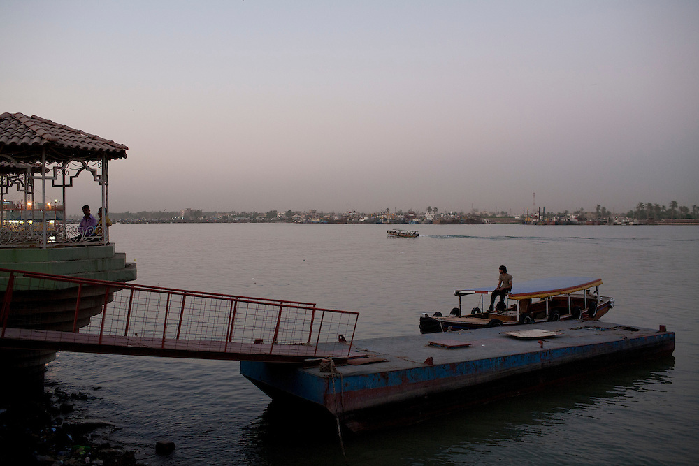 A man sits on a boat on the Shatt al-Arab on Friday, October 22, 2010 in Basrah, Iraq.