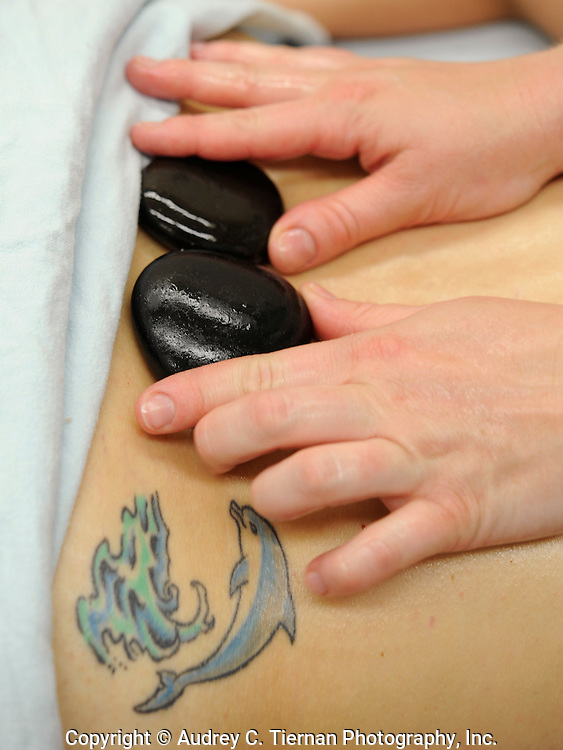 Bayside, NY: April 30, 2009---  Hot stones are used in a college massage class. Copyright: Audrey C. Tiernan