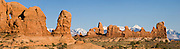 The La Sal Mountains rise behind arches, buttes, and pinnacles of the Windows Section of Arches National Park, Utah, USA. (Panorama stitched from 5 photos.)