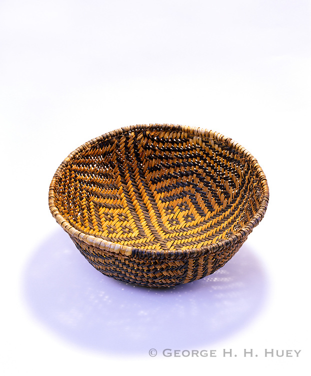 0405-1135 ~ Copyright: George H.H. Huey ~ Basketmaker period woven bowl shaped ring basket.  Made from yucca leaves; with some dyed black.  Mesa Verde National Park, Colorado.
