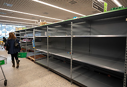 © Licensed to London News Pictures. 11/03/2020. London, UK. Empty shelves continue on the toilet roll aisle in a Wandsworth ASDA as the Chancellor Rishi Sunak increased sick pay for workers and allocates £30 Billion to help the NHS fight the Coronavirus disease. Photo credit: Alex Lentati/LNP