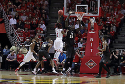 20 March 2017:  Paris Lee(1) rainbows a shot over Tacko Fall during a College NIT (National Invitational Tournament) 2nd round mens basketball game between the UCF (University of Central Florida) Knights and Illinois State Redbirds in  Redbird Arena, Normal IL