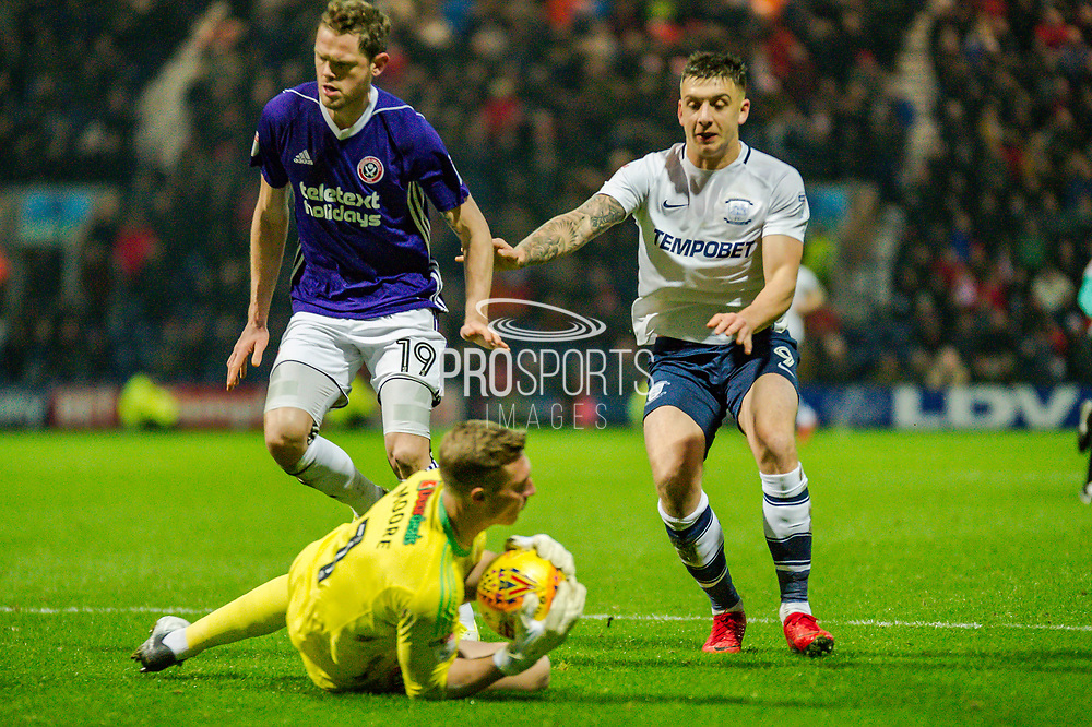 Preston North End Jordan Hugill (9) and Sheffield United Richard Stearman (19) and Sheffield United Simon Moore (1) during the EFL Sky Bet Championship match between Preston North End and Sheffield Utd at Deepdale, Preston, England on 16 December 2017. Photo by Michał Karpiczenko.