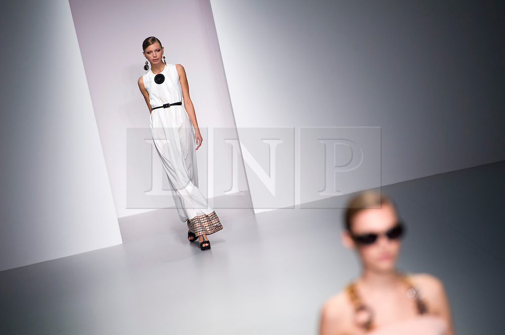 © London News PIctures. 13/09/2013. London, UK.   A model walking the catwalk at the Daks catwalk show by Filippo Scuffi  at London Fashion Week Spring/Summer 2014. Photo credit: Ben Cawthra/LNP