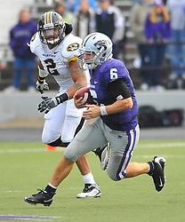 Nov 14, 2009; Manhattan, KS, USA; Kansas State quarterback Grant Gregory (6) runs for yardage as Missouri defensive end Brian Coulter (2) attempts the tackle in the fourth third quarter at Bill Snyder Family Stadium. The Tigers won 38-12. Mandatory Credit: Denny Medley-US PRESSWIRE