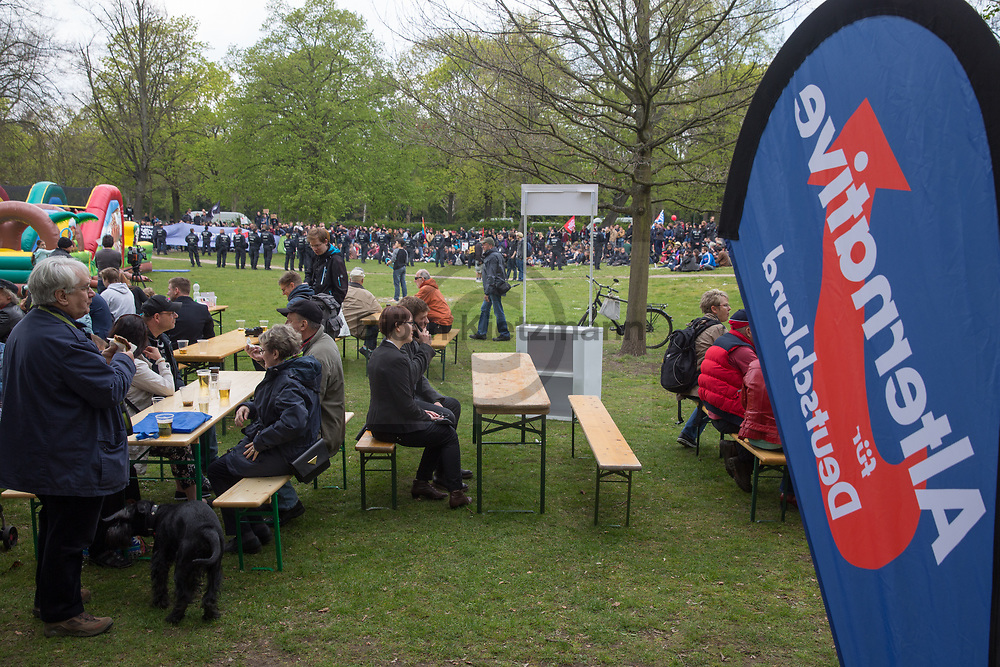 Berlin, Germany - 01.05.2017<br /> <br /> AfD celebration in Berlin-Pankow. Because of counter-protests, the celebration of the right-wing populist party Alternative for Germany (AfD) inside the Buergerpark Pankow take place under police protection.<br /> <br /> AfD-Fest in Berlin-Pankow. Aufgrund von Gegenprotesten findet ein Fest der rechtspopulistischen Partei Alternative fuer Deutschland (AfD) im Buergerpark in Pankow unter Polizeischutz statt.<br /> <br /> Photo: Bjoern Kietzmann