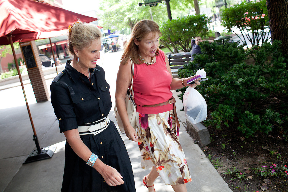Political aide Susan Duprey (R) walks with Ann Romney, the wife of Mitt Romney, after a campaign event at  Michele's Ristorante in Keene, NH on August 11, 2011.  (Matthew Cavanaugh for The Boston Globe)