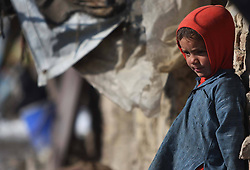 An Afghan refuge child stands near a tent at a refugee camp, Kabul, Afghanistan, January 2, 2013. Photo by Imago / i-Images...UK ONLY