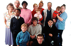 Multiracial group of people including boy with learning difficulties; boy with disability who is wheelchair user and adult with hearing impairment,