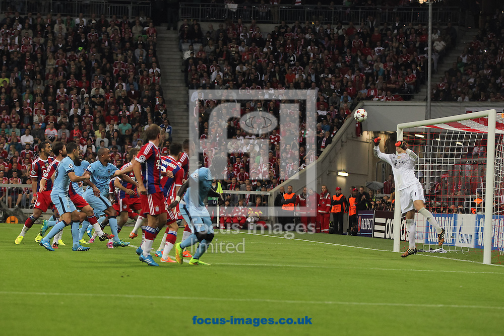 Bacary Sagna (centre) of Manchester City heads the ball towards goal during the UEFA Champions League match at Allianz Arena, Munich<br /> Picture by Tom Smith/Focus Images Ltd 07545141164<br /> 17/09/2014