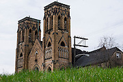"""Holy Trinity Church is a gothic-revival style church dedicated in 1907 in Duquesne, Pa. <br /> <br /> Holy Trinity served its congregation until the 1960's.<br /> <br /> Duquesne was home to the Duquesne Works steel mill that was part of Carnegie Steel Corporation and later part of U.S. Steel. It was home to the largest blast furnace in the world, named the """"Dorothy Six""""<br /> <br /> The city's population peaked in 1930, then declined with along with the decline of the steel industry. Today Duquesne has fewer total residents then worked in its steel mill."""