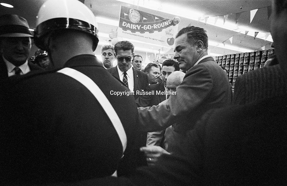 September 21, 1959. Quality Food Supermarket gets a visit from Khrushchev accompanied by Henry Cabot Lodge, the American Ambassador to the United Nations who was his American guide. The bold head of Kruschev was surrounded by police and security who were at least half a foot taller than him, causing problems for photographers..<br /> <br /> 21 septembre 1959. Le Supermarch&eacute; &quot;Quality Food&quot; re&ccedil;oit la visite de Nikita Khrouchtchev accompagn&eacute; de Henry Cabot Lodge, ambassadeur am&eacute;ricain aux Nations Unies qui &eacute;tait son guide am&eacute;ricain. La t&ecirc;te chauve de Khrouchtchev &eacute;tait entour&eacute; par la police et la s&eacute;curit&eacute; qui &eacute;taient au moins 20 centimetres plus grand que lui, ce qui as provoque des soucis pour les photographes ..