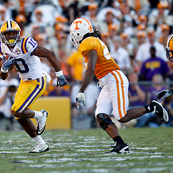 Oct 2, 2010; Baton Rouge, LA, USA; Tennessee Volunteers cornerback Art Evans (25) pursues LSU Tigers wide receiver Russell Shepard (10) during the second half at Tiger Stadium. LSU defeated Tennessee 16-14.  Mandatory Credit: Derick E. Hingle