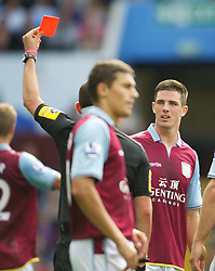 BIRMINGHAM, ENGLAND - Saturday, August 25, 2012: Aston Villa's Ciaran Clark is shown the red card and sent off during the Premiership match against Everton at Villa Park. (Pic by David Rawcliffe/Propaganda)