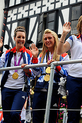 Team GB British gold medal-winning cyclists Laura Trott and Danni King   during a parade in central London celebrating Team GB athletes who competed in the London 2012 Olympic and Paralympic Games, September 10th 2012. Photo by Chris Joseph/i-Images.