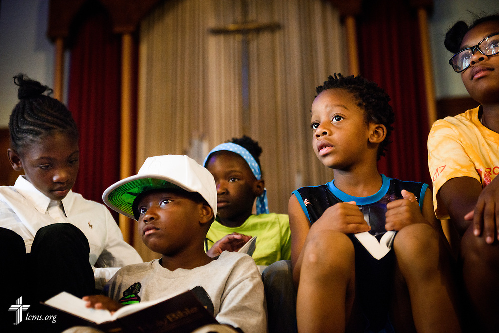 Campers listen to a Bible story during vacation Bible camp at East Bethlehem Lutheran Church, Detroit, Mich., on Wednesday, June 21, 2017, in Detroit. LCMS Communications/Erik M. Lunsford