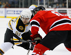 Dec 23, 2008; Newark, NJ, USA; Boston Bruins right wing Phil Kessel (81) gets ready to face off against New Jersey Devils center Dainius Zubrus (8) during the first period at the Prudential Center.