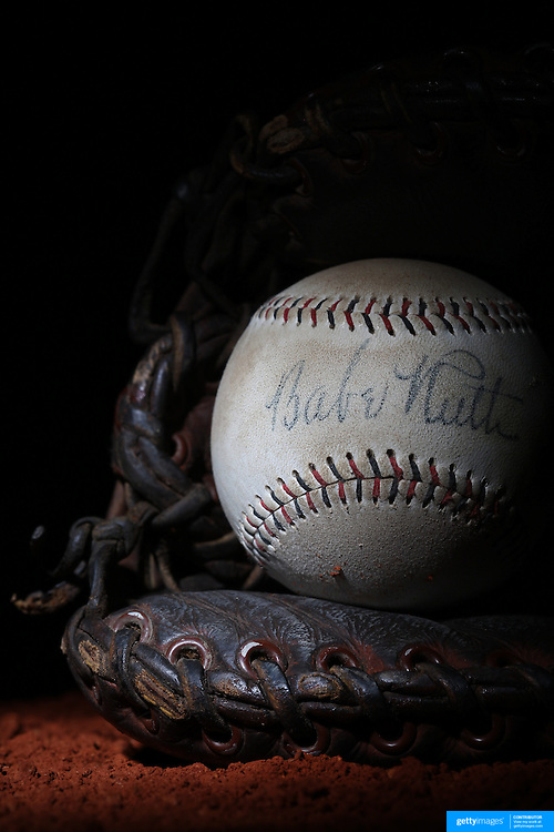 A Babe Ruth signed baseball in a antique vintage baseball mittt. 7th June 2012. Photo Tim Clayton
