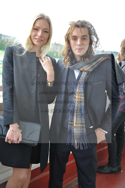LADY CLARA PAGET and OSCAR TUTTIETT at the Hennessy Gold Cup at Newbury Racecourse, Berkshire on 26th November 2011.