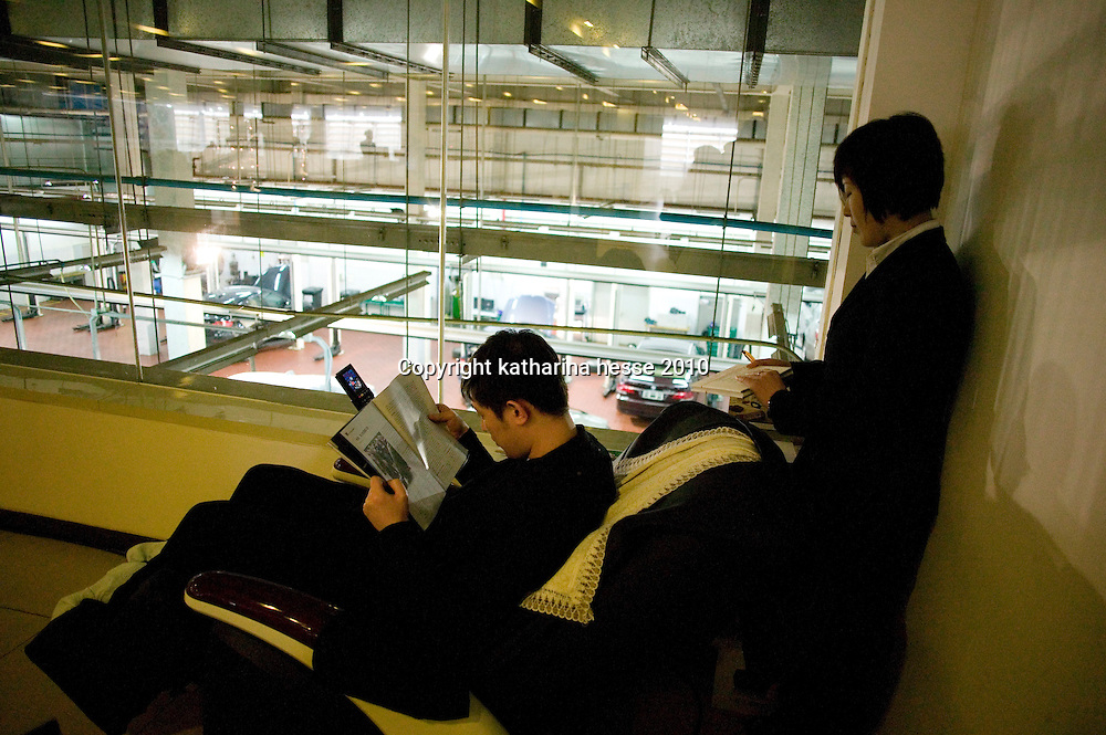 BEIJING, APRIL-22, 2010:   customers relax in on a massage chair   while waiting for their cars at the BMW dealership .