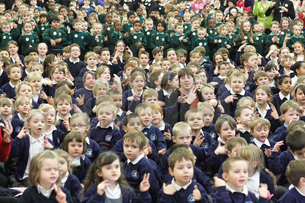© Licensed to London News Pictures. 08/02/2012. STOKE MANDEVILLE, UK.  2,000 local school children pack Stoke Mandeville Stadium in Buckinghamshire in an attempt to break the world record for simultaneous deaf signing.  The sign2sing event is organised by charity SignHealth who work with profoundly deaf children, young people and adults throughout the UK, whose first language is not English but British Sign Language. Nationally over 130,000 children from 975 schools are expected to take part, beating the previous record of 94,489 participants set by the charity last year. *** Taken with permission of event organiser ***. Photo credit :  Cliff Hide/LNP