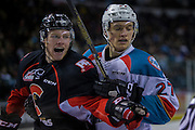 KELOWNA, CANADA - FEBRUARY 18:  Calvin Thurkauf #27 of the Kelowna Rockets and Jared Bethune #21 of the Prince George Cougars at the Kelowna Rockets game on February 18, 2017 at Prospera Place in Kelowna, British Columbia, Canada.  (Photo By Cindy Rogers/Nyasa Photography,  *** Local Caption ***