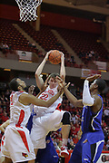 17 November 2010: Jon Ekey pulls down a defensive rebound sandwiched between Jackie Carmichael and Kenny Moore during an NCAA basketball game between the Tennessee State Tigers and the Illinois State Redbirds at Redbird Arena in Normal Illinois.