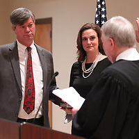 John White, left, takes his oath of office for the Circuit Court Judge from outgoing judge Jim Pounds Friday morning in Booneville.