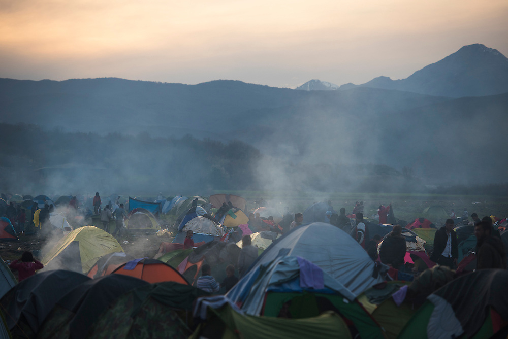 A refugee camp on the Macedonian (FYROM) border is seen at dusk on March 8, 2016 in Idomeni, Greece.