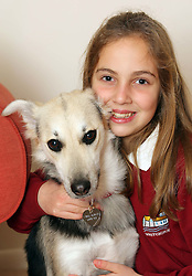 Alyssa  Smith (11) re-united with her dog Holly at her home in Andover, Hants, after her parents  paid £1,300 to have the dog flown back to Britain after it was found abandoned in Dubai . Stephen Lock / i-Images