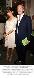 Model LISA B and ANTON BILTON, at a party in London on 2nd July 2002.PBO 143