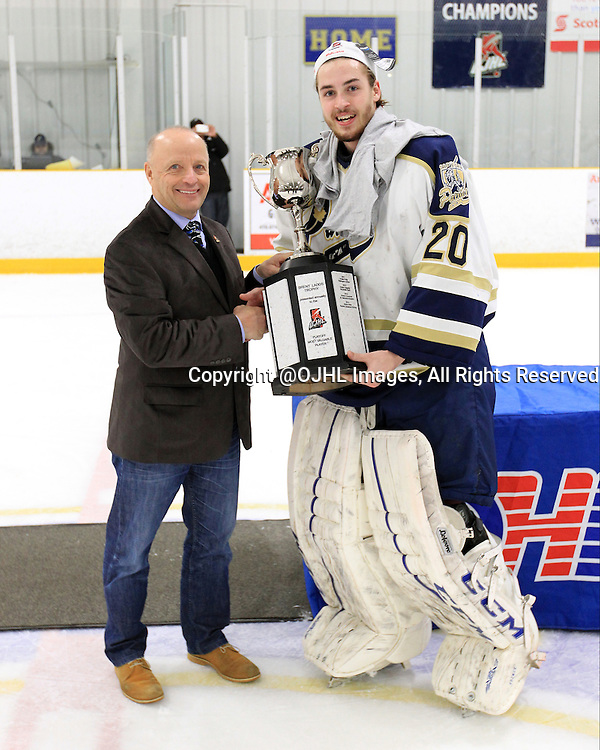 TORONTO, ON - Apr 22, 2015 : Ontario Junior Hockey League game action between the Toronto Patriots and the Kingston Voyageurs. Game seven of the Buckland Cup Championship Series. Mr Brent Ladds presents Mathew Robson #20 of the Toronto Patriots the Playoff MVP.<br /> (Photo by Tim Bates / OJHL Images)