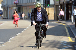 Image ©Licensed to i-Images Picture Agency. 24/07/2014. London, United Kingdom. <br /> <br /> Mayor of London Boris Johnson arrives at Stratford Park, East London, on his bike, after he announced a £1m investment in his Free Sport Programme for Londoners.<br /> <br /> Picture by Ben Stevens / i-Images