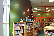 Part of the aluminum cone from the exterior can be seen in the school's library at Atherton.