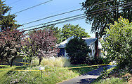 Police investigate the home where 12 girls were found, ranging in age from 6 months to 18 years old, this week after a neighbor called police Saturday, June 18, 2016 in Feasterville, Pennsylvania.   (Photo by William Thomas Cain)