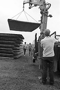 Fences being built with the help of a crane, at Glastonbury, 1989.