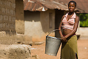 A girl holds a bucket in the village of Mabanta on Friday February 27, 2009.