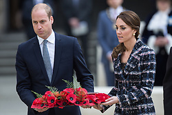 © Licensed to London News Pictures . 14/10/2016 . Manchester , UK . The Duke and Duchess of Cambridge lay a wreath during a service at the Cenotaph at Manchester Town Hall during a dedication service , on their visit in Manchester . Photo credit : Joel Goodman/LNP